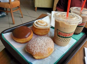 Krispy Kreme: a selection of doughnuts and coffee.