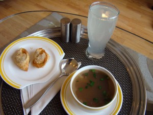 From room service: a fresh lime soda and a won ton vegetable soup, both good.