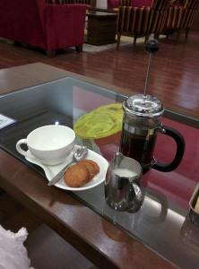 At the Tea Lounge in Lemon Tree Premier: Kenyan AA Masai coffee and cookies.