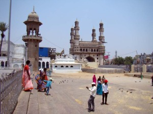 Outside the Mecca Masjid: a family gets photographed against a backdrop of the Charminar.