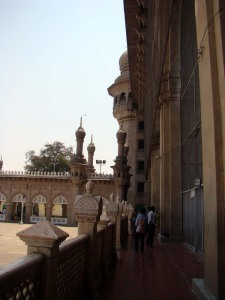 Looking up towards the central arch of the Mecca Masjid, decorated with bricks of soil brought from Mecca.