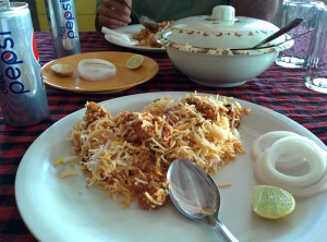 Biryani, sliced onions and lime at Pista House.