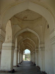In the arched colonnade of Hayat Baksh Begum's tomb.