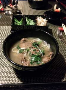 Pho at Republic of Noodles. A tray of garnishes - sprouts, basil and mint - sits in the background.