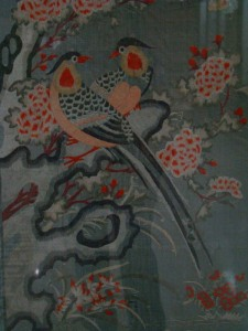 Detail from an embroidered panel in the Chinese Gallery.