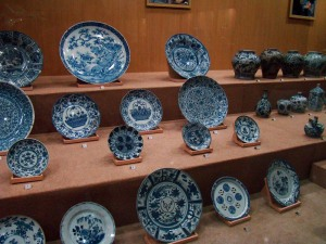 A display of blue and white Ming porcelain.