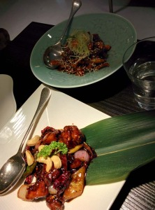 Mains: Kung pao chicken (in front), and, at the back, crispy lamb with raw mango.