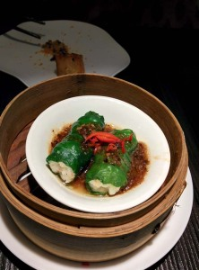 Prawn-stuffed spinach rolls, served with a spicy sauce.