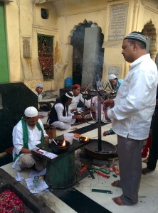 At the dargah, a small group of qawwals beside the tomb of Zia'uddin Barani.