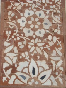 White and black marble inlay on red sandstone, at a gate in Sikandra.