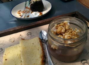 The chocolate pot de creme, topped with caramel popcorn and served with lemon poppy seed cake.