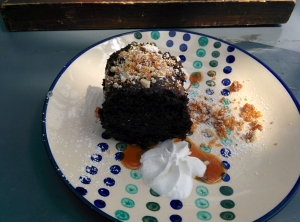 The Old Monk(ey) chocolate cake, served with whipped cream and praline.