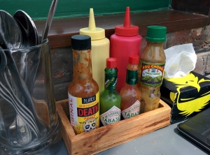 The hot sauces at our table.
