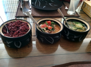Our main course, lined up: wild red rice, arsa chhum, and bai.