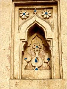 Blue tile in a niche on the tomb wall.