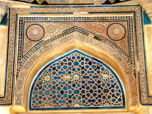 Incised plaster and tile decorate an arch inside the tomb.