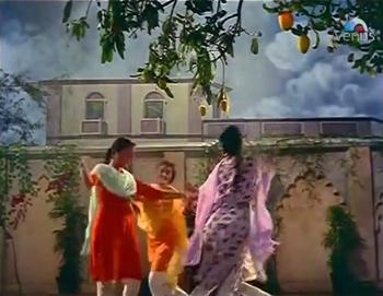 Zeenat and her friends cavort under a mango tree