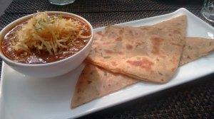 Parsi salli boti, served with paratha.