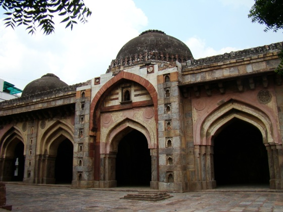 A view of Moth ki Masjid, with its blackened domes.