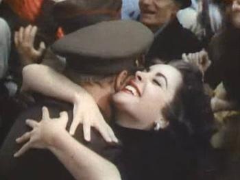 A strange girl hugs and kisses Charlie Wills