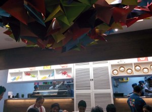 A ceiling installation at Yum Yum Cha: 250 origami butterflies.