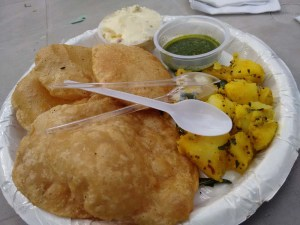 Shrikhand-puri, with potato sabzi and green chutney.