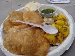 Shrikhand-puri, with potato sabzi and green chutney.
