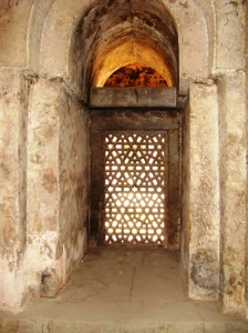 Inside the zenana masjid - a glimpse of a stone filigree screen, or jaali.
