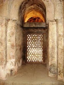 Inside the zenana masjid - a glimpse of a stone filigree screen, or jaali.