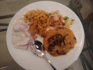 Kathal biryani, salad, onion raita, and baingan mirch ka salan.