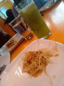 Lemon zest and mint lemonade, and a serving of som tam, raw papaya salad.