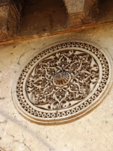 A decorative detail: a medallion made of incised plaster.