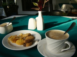 Teatime at The Glasshouse: coffee and a plate of assorted cookies and namak paras.