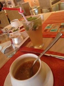 At Peninsular Kitchen: a mulligatawny, and a coconut mojito at the back.
