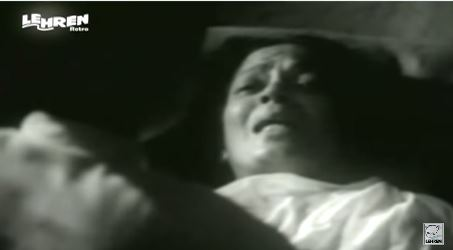 Kishan's mother, on her deathbed