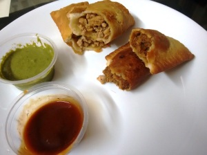 Hand pies: chicken in oyster sauce, and pulled pork in BBQ sauce - served with two sauces.