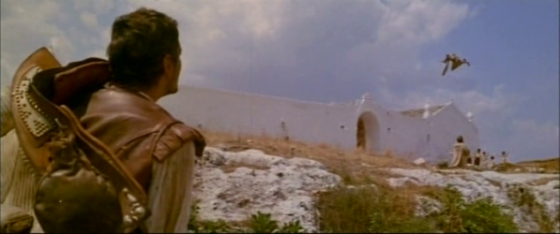 Rodrigo arrives at a monastery above which a monk flies