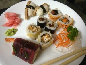 An assortment of sushi, some vegetarian and some not.