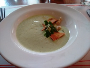 Chilled avocado and yoghurt soup with fresh cilantro and mint.