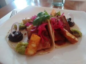Pork belly with marinated pineapple, on flour tortillas.
