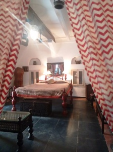 Inside Malabar Mahal: the height of that bed is impressive!