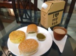 An array of snacks: keema pav (with some green chutney on the side), bun maska, bun bhujia - and a kulhad of chai.