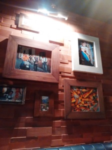 A wall at the restaurant, decorated with framed photos of Jamie, pals, Italy, etc.