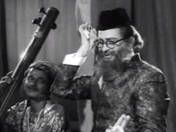 Chand, as Khan Sahib, sings a song
