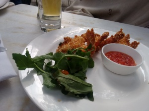 Scampi with sesame seeds, rocket, and a sweet chilli dipping sauce.