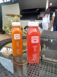 Two types of cold-pressed juices; orange, and melony.