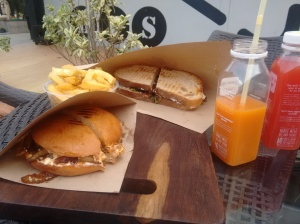 Sandwiches, fries and juice.