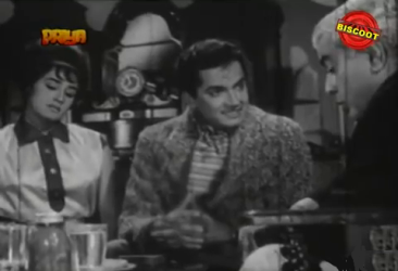 Ramesh plots with his mother and Mukta's father