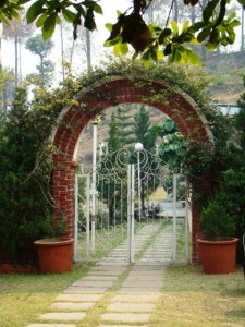 A gate leading from the Kafal Bagh to Harkison Hall.