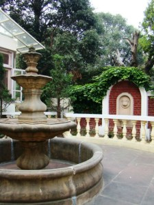 A couple of fountains and pretty stone benches, outside The Kumaon Room.